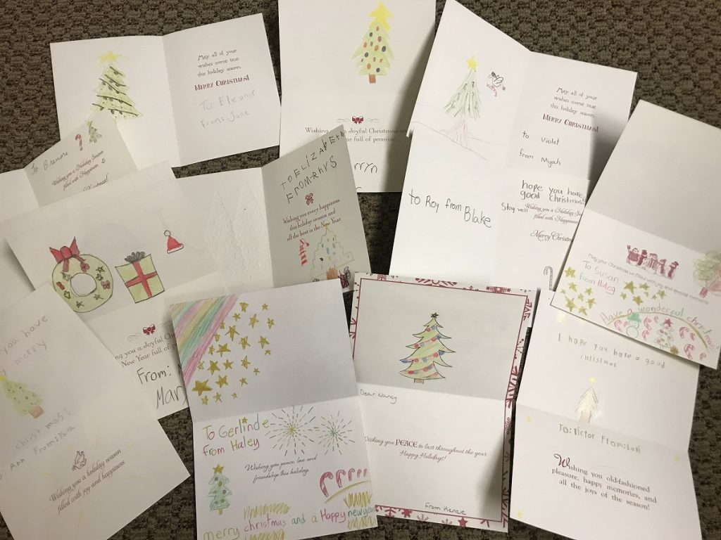Kids writing Christmas cards to the seniors in our community