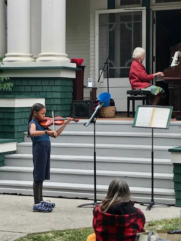 violin student performing in the outdoor recital at the Vernon Community Music School